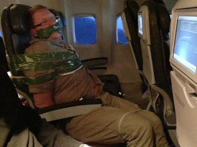 drunk-man-on-flight-duct-taped-to-seat