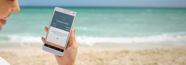 Using the CurrencyFair app on the beach