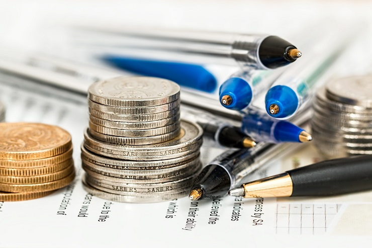stacks-of-coins-and-pens