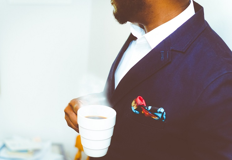 man-in-suit-with-coffee