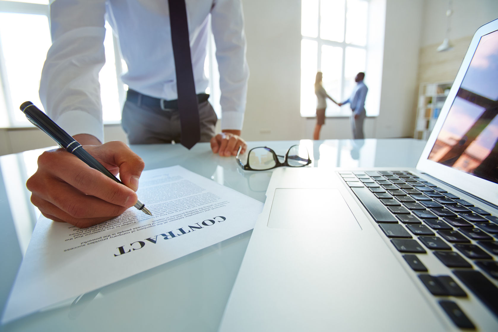 lawyer-developing-contract-of-partnership