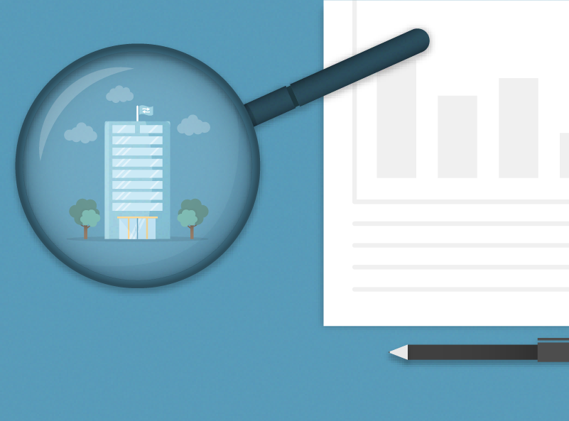 Magnifying glass over company building, graph and pen