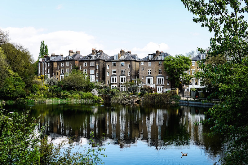 row of old english houses at lakeside