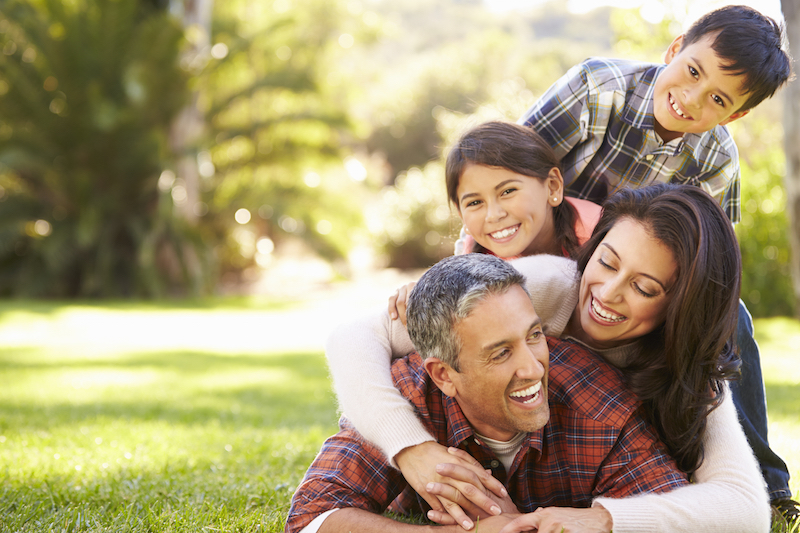 family laughing on grass