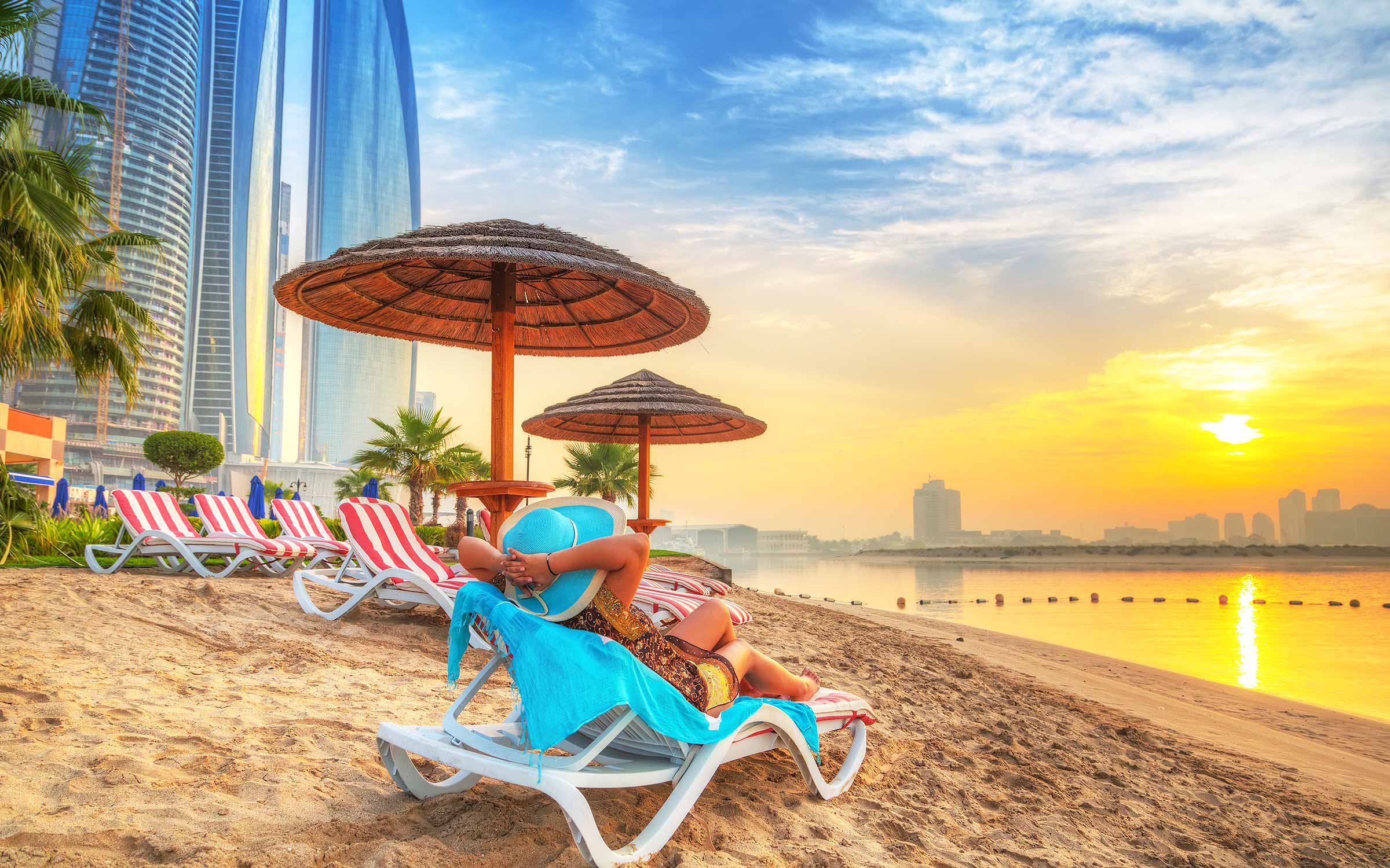 woman on beach lounger in UAE