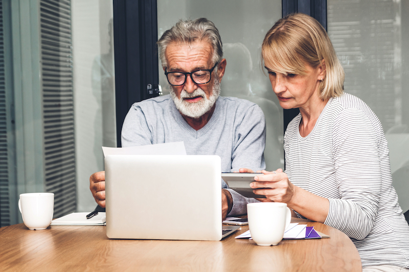 older couple looking concerned at laptop